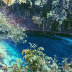 The Hinatuan Enchanted River - a deep spring river on the island of Mindanao in the Philippines.